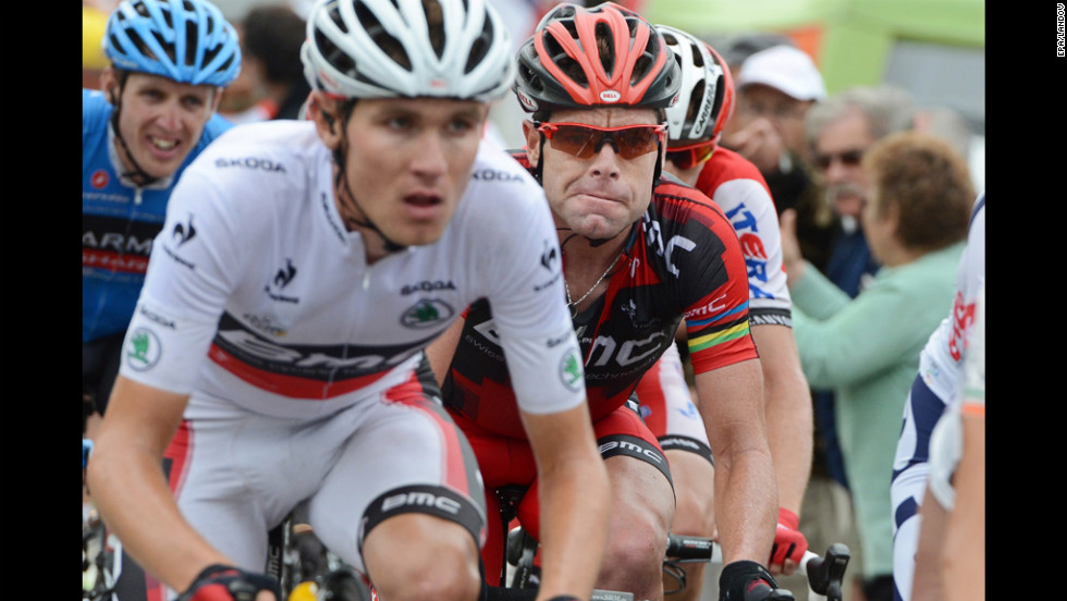 "Australian rider Cadel Evans of Team BMC, right, follows closely behind teammate Tejay Van Garderen of the United States, left, who is currently wearing the race's ""best young rider's"" jersey."