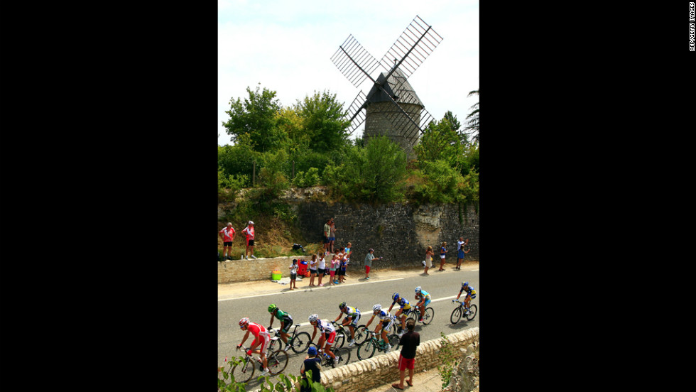 The leaders cruise past a windmill Friday on the 18th stage of the Tour de France.