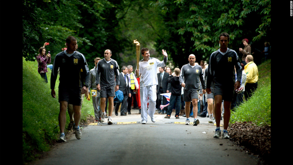 Christopher Bury carries the flame through Mote Park in Maidstone, England, on July 20.