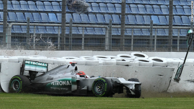 Michael Schumacher crashes in the final minutes of Friday's second practice session at the German grand prix