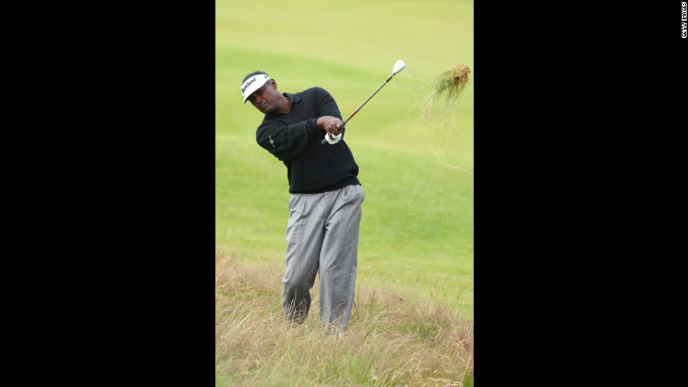 Vijay Singh of Fiji plays out of the rough on the 13th hole on Friday.
