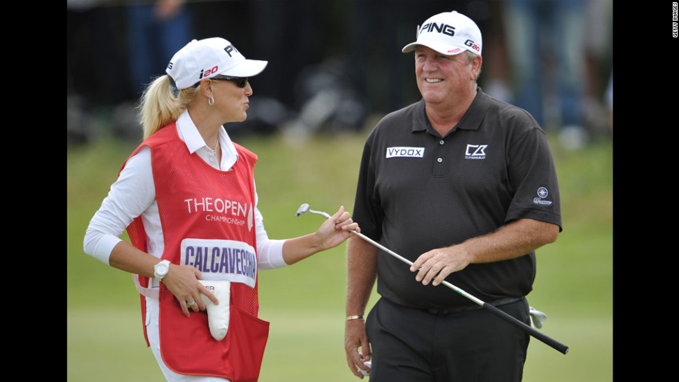Mark Calcavecchia of the United States laughs with wife (and caddie) Brenda in the third round.