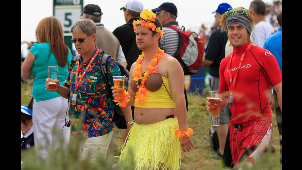 Golfers must dress appropriately to play in the Open. Rules for fans are more relaxed.