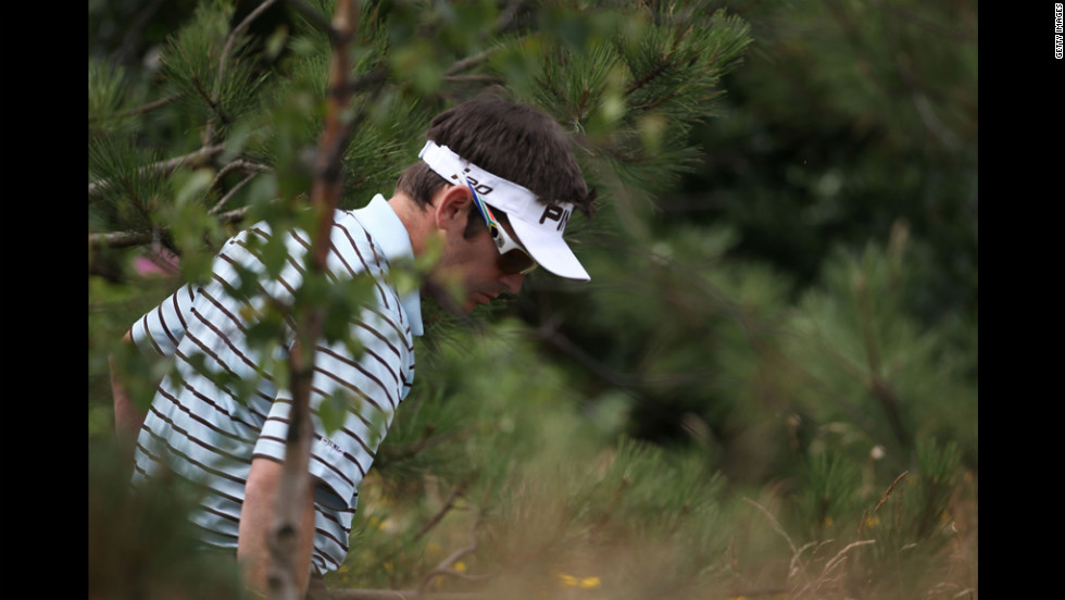 Louis Oosthuizen of South Africa searches for a lost ball on the third hole. Oosthuizen, the 2010 Open champion, was tied with several players in 10th place after Saturday's play.