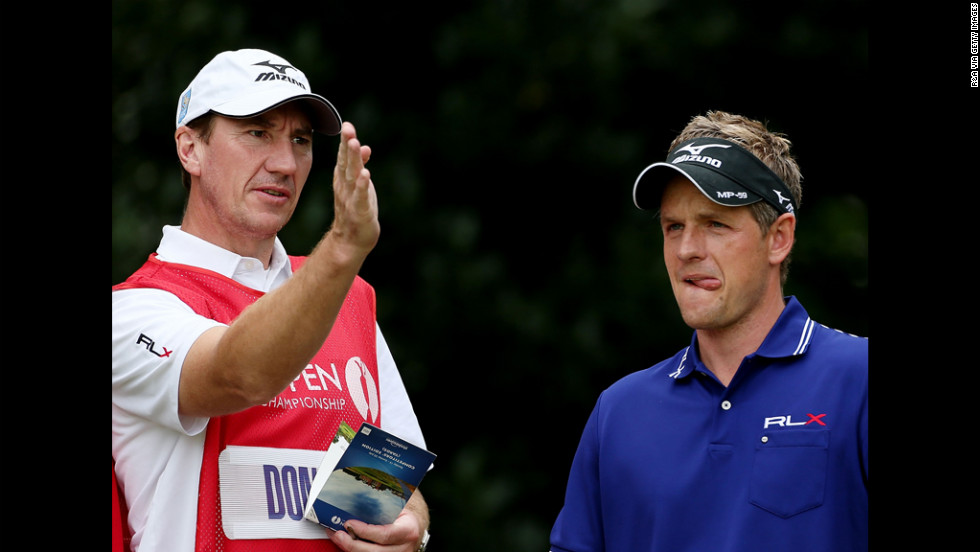 Luke Donald of England talks with caddie John McLaren.
