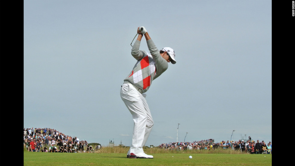 Adam Scott tees off on the fifth hole.