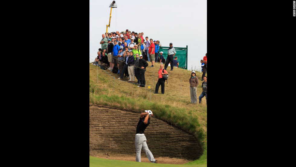 Spectators watch Olesen extract himself from one of Royal Lytham & St. Annes' many bunkers on Saturday.