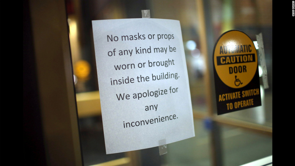 A sign prevents moviegoers from wearing masks or bringing in props to the AMC Arapahoe Crossing 16 movie theater in Aurora.