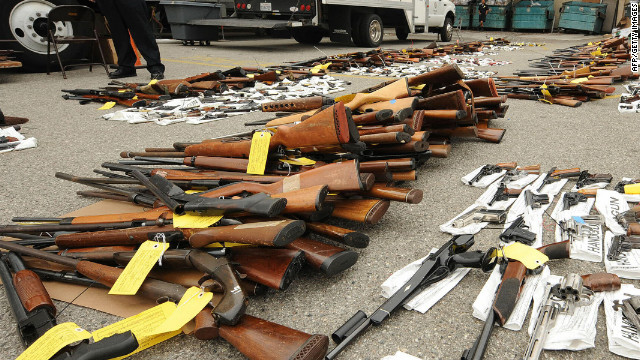 Police guard some of the more than 1,600 firearms which were voluntarily surrendered to police custody over a five-hour period last Saturday are on display at a press conference at police headquarters in Los Angeles, California on May 11, 2009. More than 1,600 firearms were voluntarily surrendered to police custody over a five-hour period May 9, 2009 in the one-day gun buyback program in which citizens who turned in a handgun, shotgun or rifle received a USD100 voucher for a local supermarket while people who turned in higher caliber assault weapons such as a AK-47, Uzi or AR-15 received a voucher worth USD200. The gun buyback program is a component of Mayor Antonio Villaraigosa's 2009 gang plan to reduce gun violence. At right is city councilmember Jack Weiss and second from left is the mayor's anti-gang czar Rev. Jeff Carr.