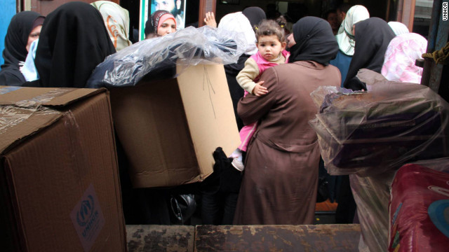 Syrian refugees wait in front of an aid supply truck in Tripoli, Northern Lebanon, in March.