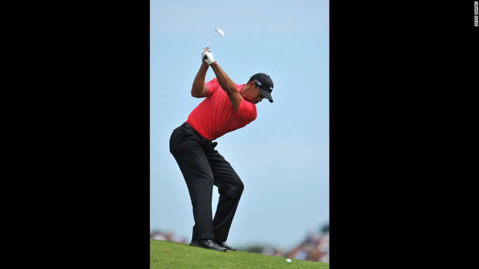 Woods, who had several bogies on the day, hits his approach shot on the second hole during the final round Sunday.