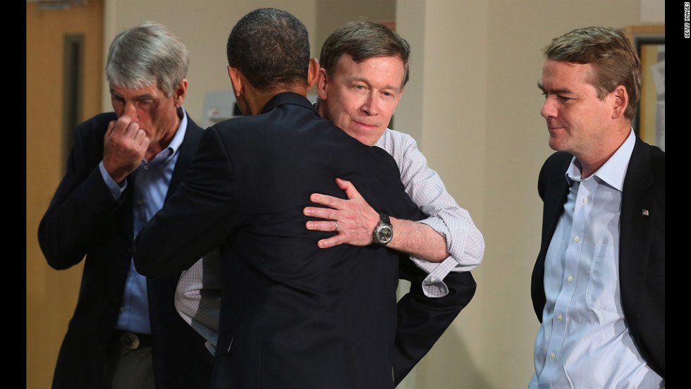 President Barack Obama embraces Colorado Gov. John Hickenlooper as Sen. Mark Udall, left, and Sen. Michael Bennet look on during a visit to the University of Colorado Hospital on Sunday.