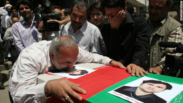 Mourners at the funeral of 35-year-old Daryoush Rezaie, the Iranian nuclear scientist who was shot dead in 2011.