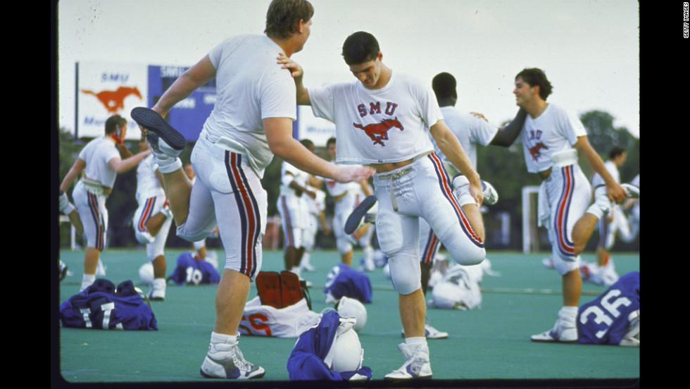 "The Southern Methodist University football team warms up in 1988, two years after a scandal broke that SMU boosters had been giving football players thousands of dollars from a slush fund with university officials' knowledge. In what was the first and last time it gave the ""death penalty"" to a football program, the NCAA suspended SMU from playing its 1987 season and banned it from recruiting. The school also was not allowed to play at home in the 1988 season and lost dozens of scholarships."