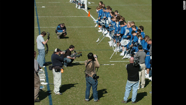 Members of the Duke lacrosse team is the center of attention as they listen to the National Anthem at their season opener on Saturday, February 24, 2007, in Durham, North Carolina.