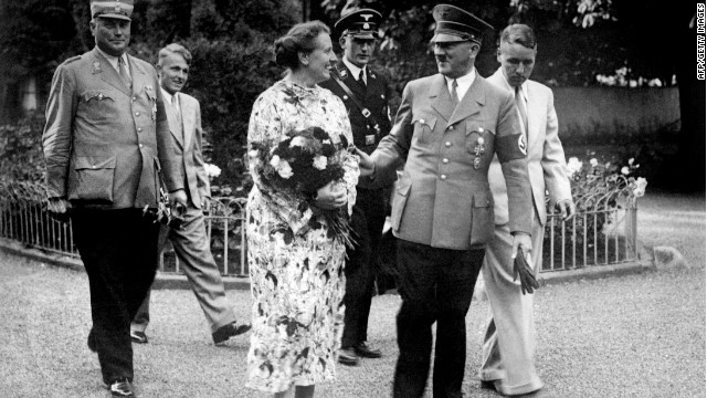 German Chancellor and Nazi Dictator Adolf Hitler, second right, talking with Winifred Wagner in the park of the Wahnfried Villa in Bayreuth in summer 1937. Winifred Wagner was the daughter-in-law of Richard Wagner and director of the Bayreuth music festival.