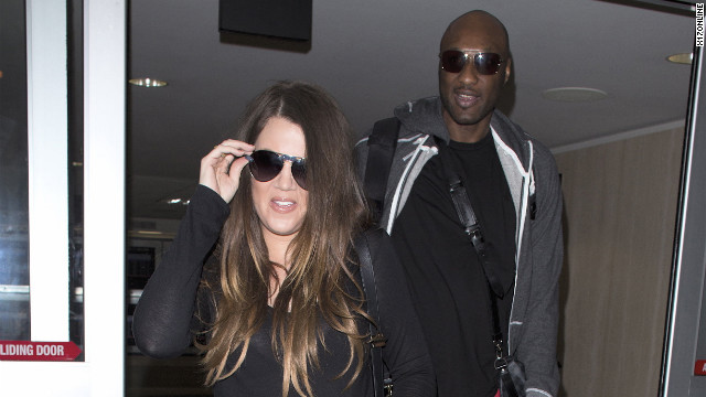 Khloe Kardashian and Lamar Odom look happily in love at LAX. July 22, 2012 X17online.com