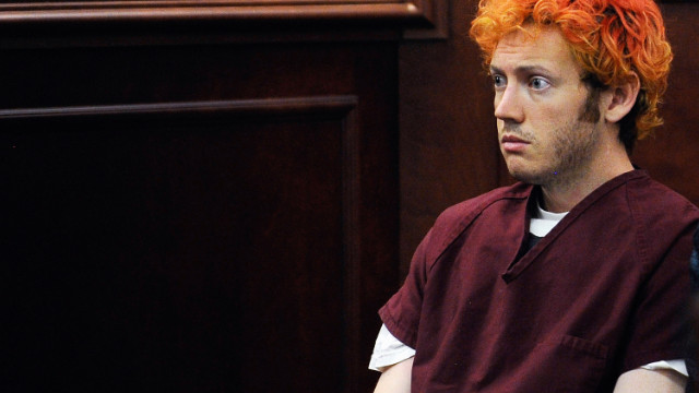 James Holmes appears dazed in court