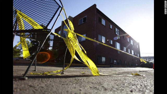 Yellow crime scene tape surrounds the apartment building where suspect James Holmes lived.