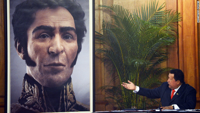 Venezuelan President Hugo Chavez shows a picture with the possible face of Liberator Simon Bolivar, a digital rendering from genetic data.