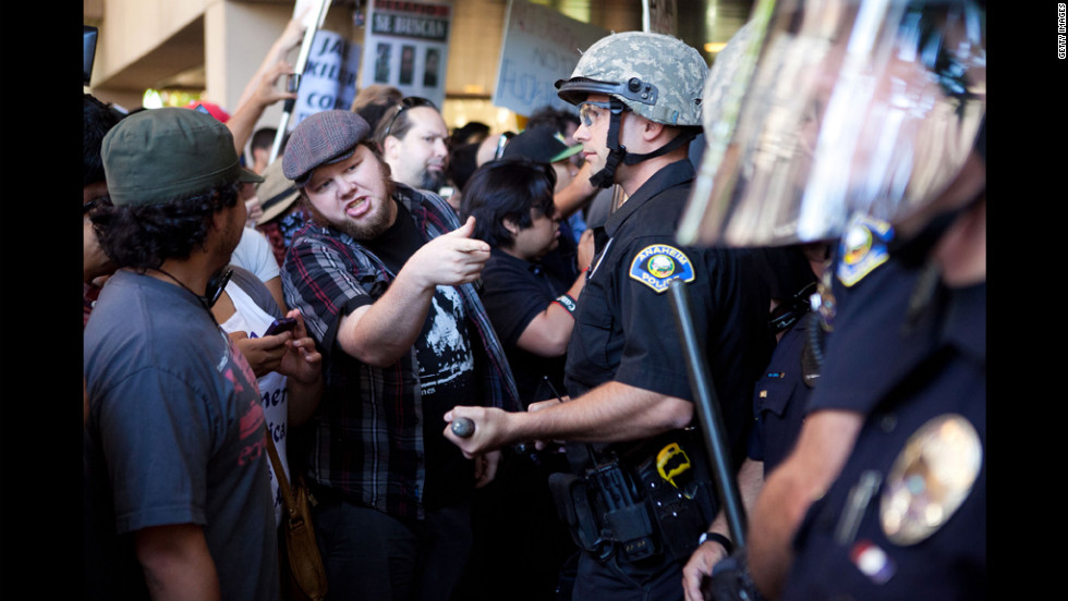 Protesters clash with police outside Anaheim City Hall.