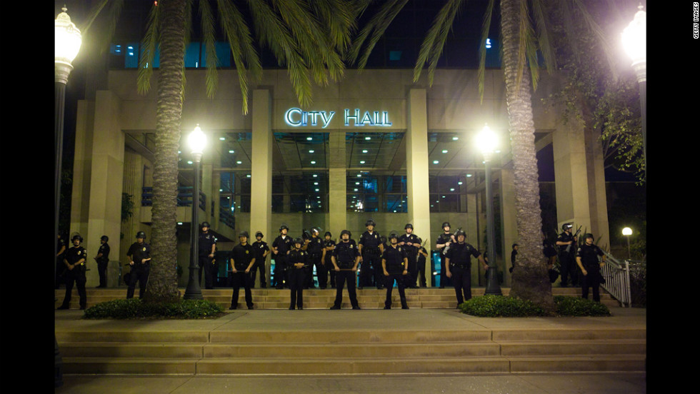 Officers stand guard in front of City Hall.