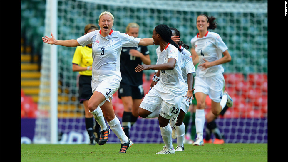 Britain's Stephanie Houghton celebrates a goal, adding the first point to the scoreboard, with teammate Ifeoma Diek.