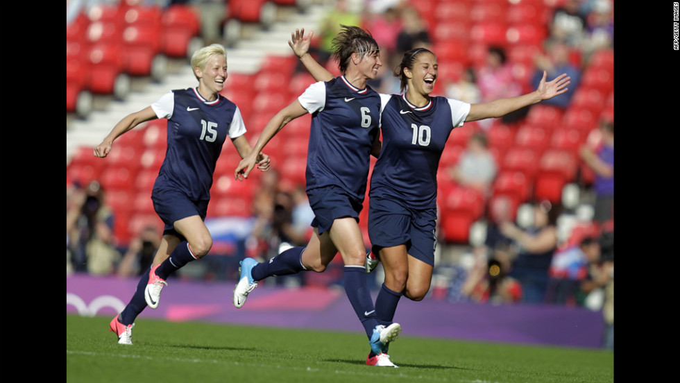 American Carli Lloyd celebrates with teammate Amy Le Peilbet after scoring her team's third goal.