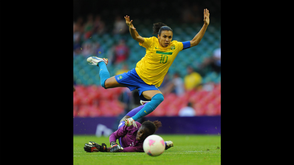 Brazil's Marta is in action with Cameroon's goalkeeper Annette Ngo Ndom during the first-round women's football competition at Millennium Stadium on Wednesday.