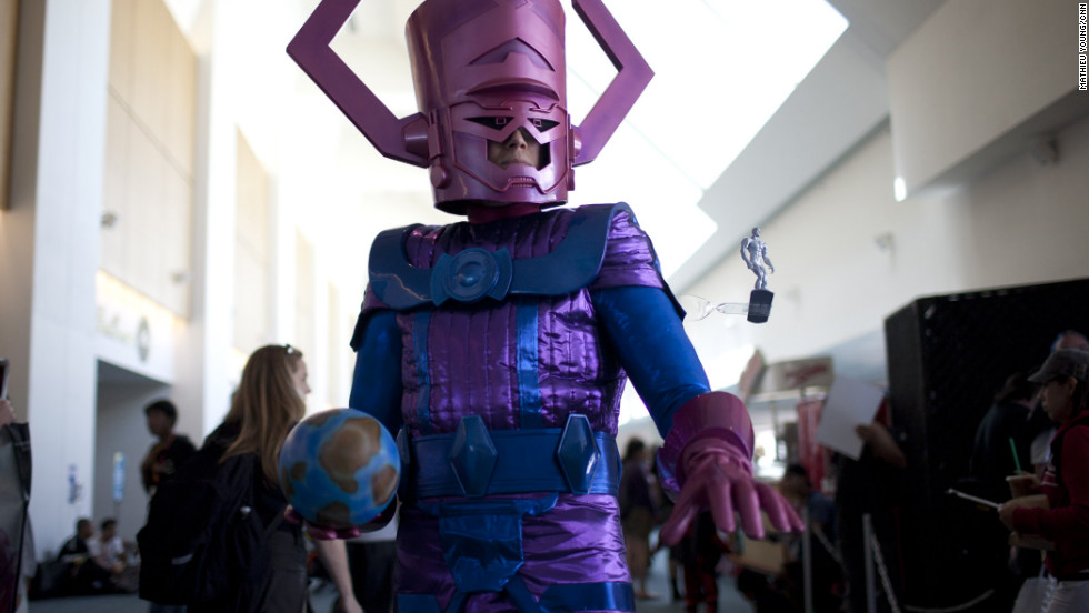 The ancient Galactus (complete with a puny, watchful Silver Surfer) brings along a planet as a Comic-Con snack.