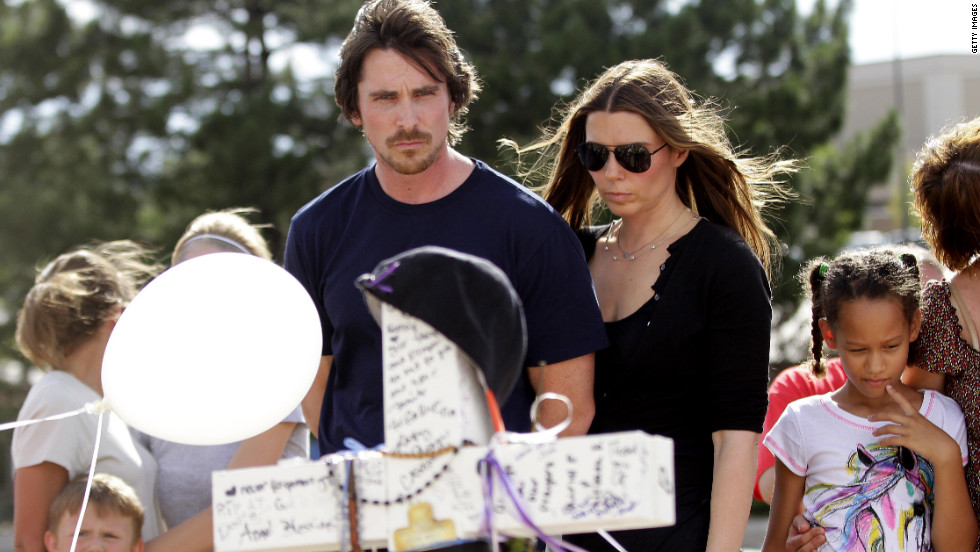 Actor Christian Bale and his wife, Sandra Blazic, visit the makeshift memorial for victims of the Aurora, Colorado, shooting across the street from the Century 16 movie theater on Tuesday, July 24.