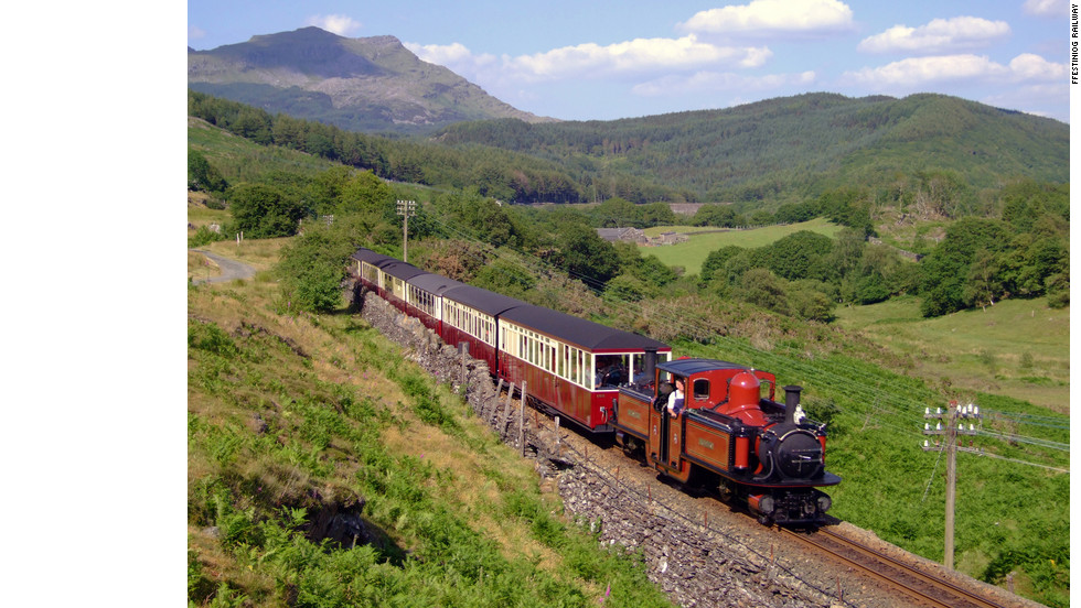 Travelers can take in breathtaking views while riding the Ffestiniog Railway in Wales.