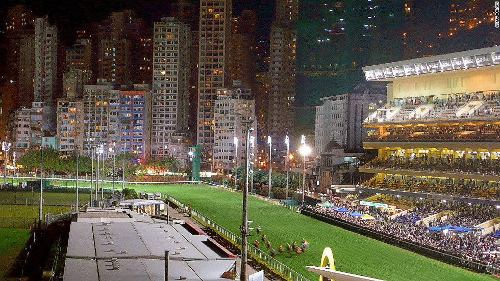 Happy Valley Racecourse was originally constructed in 1845 to provide horseracing to Britons living in Hong Kong. Due to the island's hilly terrain the only suitable area was on Happy Valley's swampland, and the government prohibited local farmers from growing rice in the immediate vicinity to allow the course to be built. Modern day Hong Kong is now a populous metropolis, providing a unique backdrop to one of Asia's greatest racecourses.