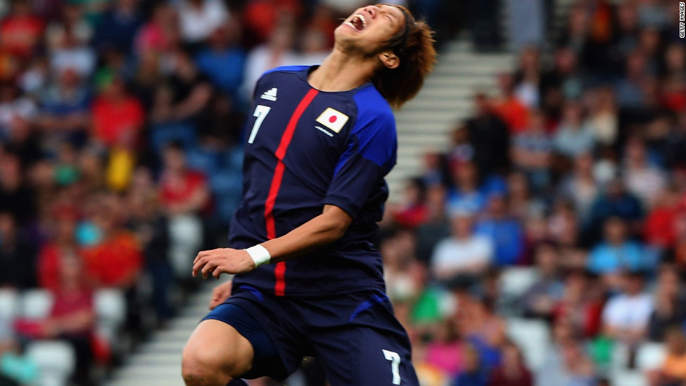 Yuki Otsu of Japan is tackled by Inigo Martinez of Spain during a first-round Group D soccer match Thursday in Glasgow.