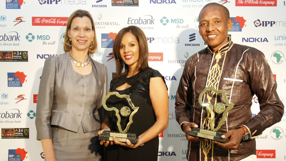 Joint winners of the MSD Health & Medical Award, Megan Small (center) and Clive Mtshali pose after receiving their award.
