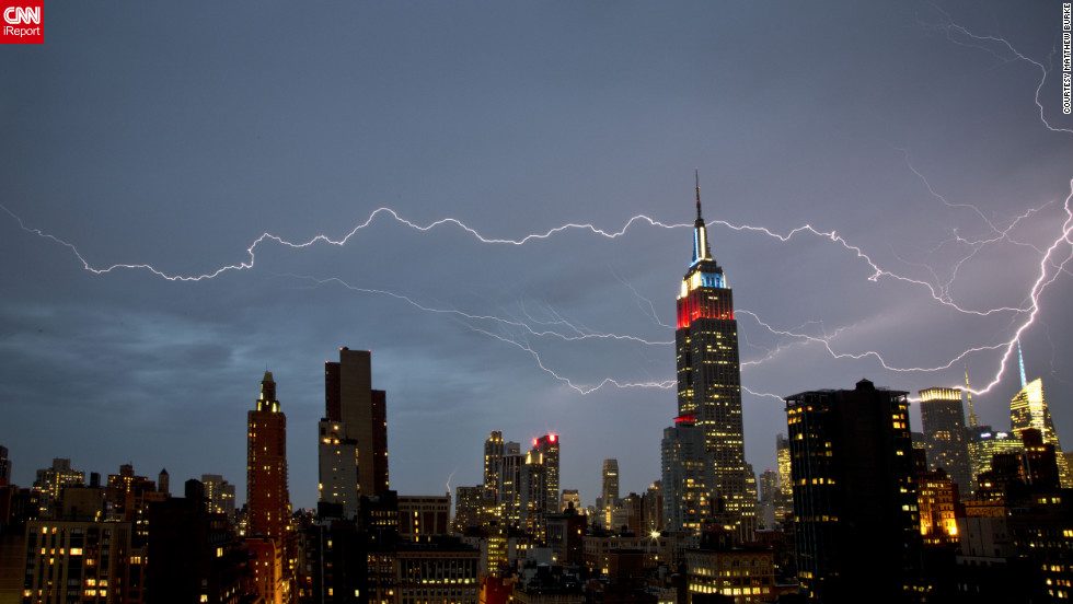 iReporter Matthew Burke reports the strong storms in New York  on Thursday night produced quite a show. He said it looked like the lightning initially struck the Bank of America building and then snaked its way through the sky.