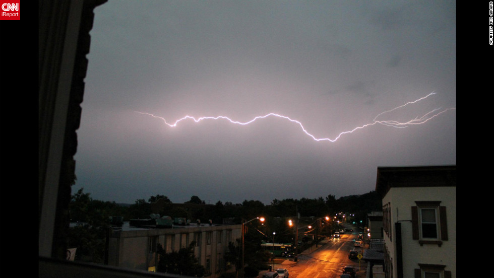 Lightning flashes across the sky Thursday, July 26, in Nyack, New York, in this dramatic photo from CNN iReporter Eric Girard. Storms ripped through the Northeast on Thursday night, unleashing strong winds and knocking out power to hundreds of thousands of customers.