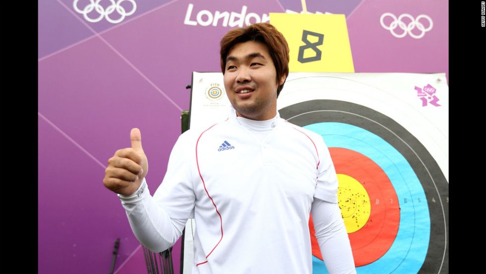 South Korean archer Im Dong Hyun celebrates breaking the first world record of the London Olympics on Friday. The two-time gold medalist, who is classified as legally blind and can't see out of his right eye, bettered his own 72-arrow mark in the qualification competition.
