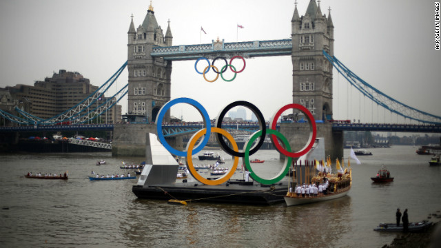 The giant Olympic rings are pictured next to Tower Bridge on the final day of the London 2012 Olympic Torch Relay on Friday.