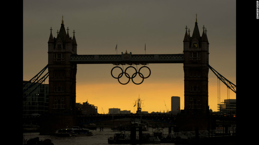 The sun sets behind the Tower Bridge in London hours before the opening ceremony of the 2012 Olympic Games on Friday.