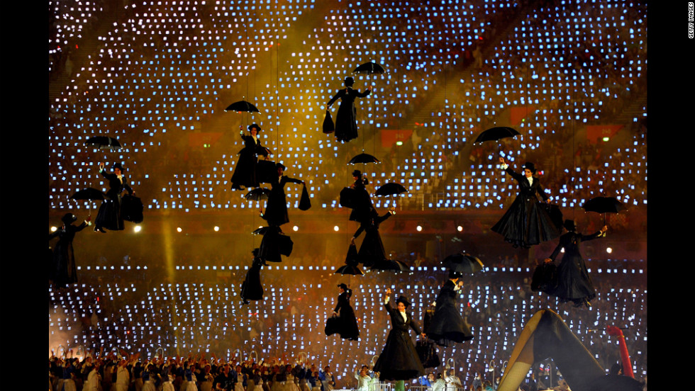 Performers float with umbrellas as they play the role of Mary Poppins.