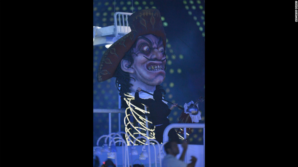 "Giant pictures depicting villains of British literature, including Captain Hook from ""Peter Pan,"" are displayed during the opening ceremony."