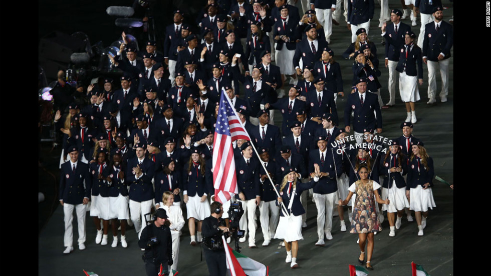 Mariel Zagunis of the United States Olympic fencing team carries her country's flag.