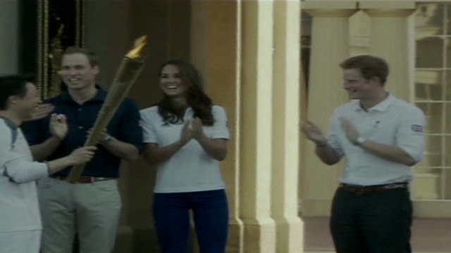 Olympic torch passes by William and Kate