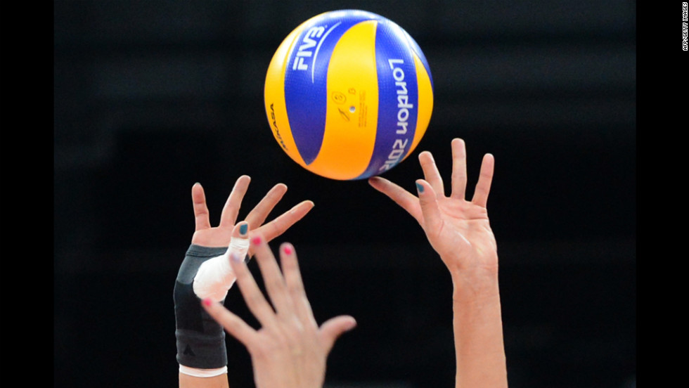 Serbia's Maja Ognjenovic, right, passes the ball during a women's volleyball match between Serbia and China.