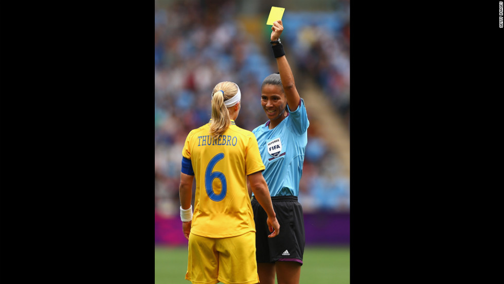 Sweden's Sara Thunebro is given a yellow card during a women's first-round soccer game.