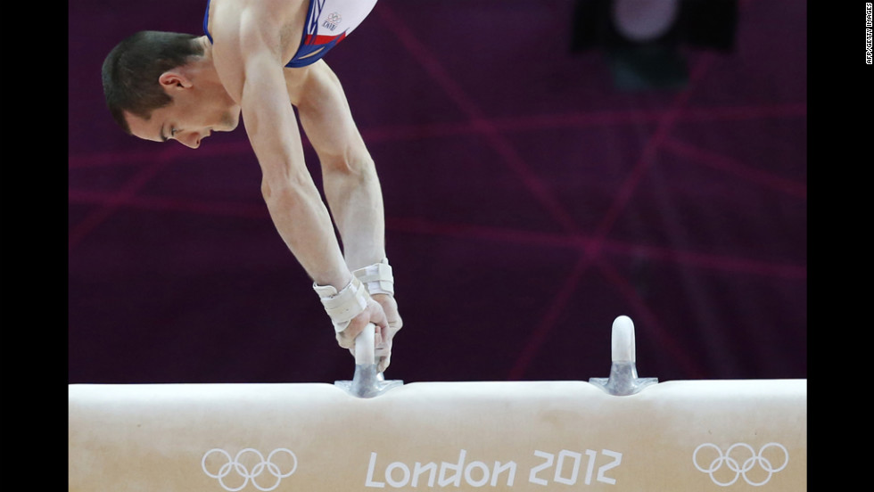 French gymnast Cyril Tommasone competes on the pommel horse during the men's qualification of the artistic gymnastics event.
