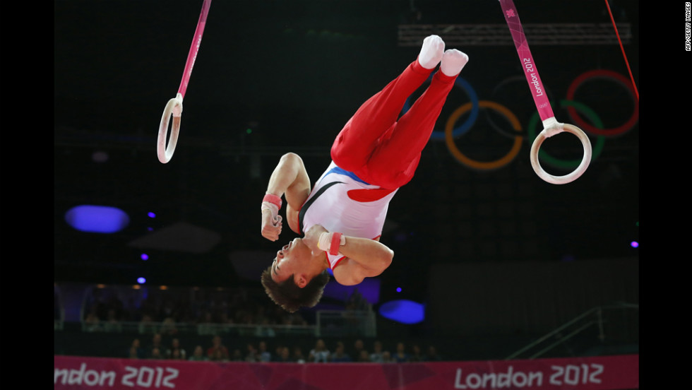 South Korea's gymnast Kim Hee Hoon competes on the rings during the men's qualification of the artistic gymnastics event.