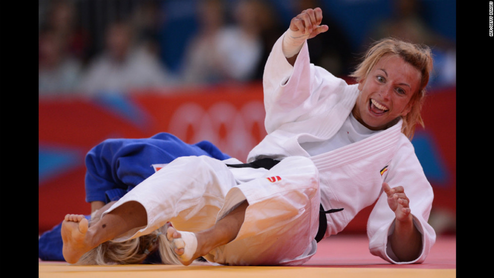 Belgium's Charline Van Snick, right, celebrates after winning against Hungary's Eva Csernoviczki during the women's judo match.