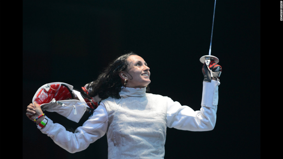 Tunisia's Ines Boubakri celebrates her victory over U.S. fencer Nicole Ross after their women's foil fencing bout.
